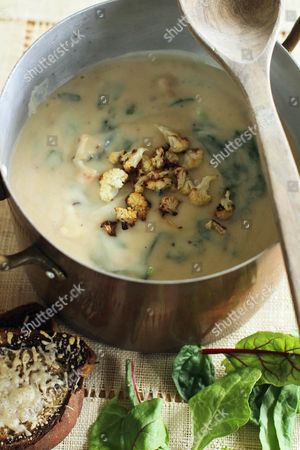 This photo shows roasted cauliflower and greens soup with cheese-covered rye toasts in Concord, N.H. This dish is from a recipe by Sara Moulton