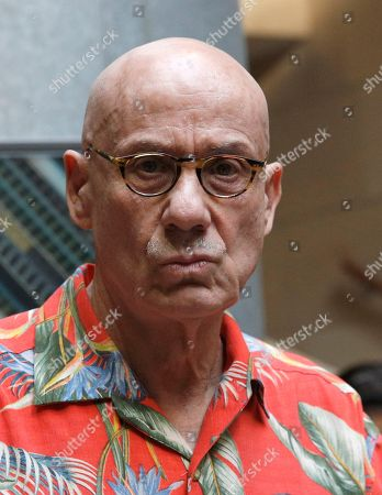 U.S author James Ellroy looks on during a signing session in Paris