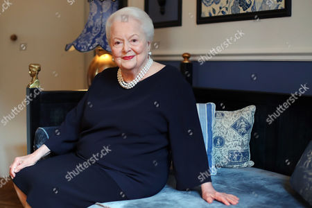 U.S. actress Olivia de Havilland poses during an Associated Press interview, in Paris, Saturday, June 18, 2016. She may be losing her sight and hearing, but the mind of the indomitable actress Olivia de Havilland, who turns 100 Friday, remains as sharp as a tack.