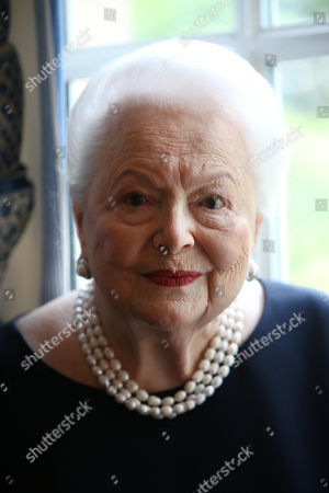 U.S. actress Olivia de Havilland poses during an Associated Press interview, in Paris, Saturday, June 18, 2016. She may be losing her sight and hearing, but the mind of the indomitable actress Olivia de Havilland, who turns 100 Friday, July 1, 2016 remains as sharp as a tack.