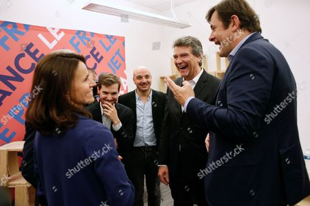 Former French economy minister and candidate Arnaud Montebourg, second from right, talks with former French Culture Minister Aurelie Filippetti, left, and his campaign spokesperson Francois Kalfon, right, during the inauguration of his campaign headquarters for the 2017 presidential election, in Paris