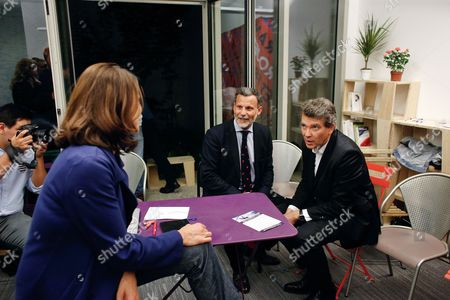 Former French economy minister and candidate Arnaud Montebourg, right, talks with former French Culture Minister Aurelie Filippetti, left, and socialist deputy Patrice Prat, center, during the inauguration of his campaign headquarters for the 2017 presidential election, in Paris