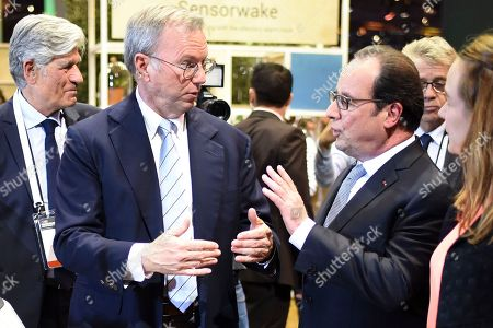 French President Francois Hollande  talks with  Alphabet Inc Executive Chairman Eric Schmidt (2nd L) and French President Francois Hollande (2nd R) next to Publicis Group Directory Board Chairman Maurice Levy, left, and French Minister of State for the Digital Sector Axelle Lemaire at the Viva technology event in Paris Thursday, June 30, 2016.