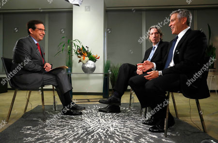 George Clooney, John Prendergast, Chris Wallace Actor George Clooney, right, and John Prendergast, center, talk during an interview with FOX News Sunday's Chris Wallace in Washington