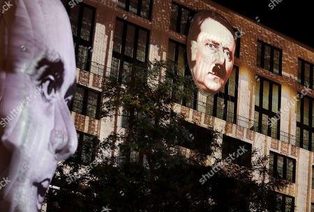 The faces of Adolf Hitler, right, and Joseph Goebbels, left, are projected onto 3D canvases as part of an art installation during a rehearsal for the 'Berlin Leuchtet' (Berlin shines) festival in Berlin, Germany, . 'Berlin Leuchtet' takes place from Sept. 30 until Oct. 16, 2016 in the German capital