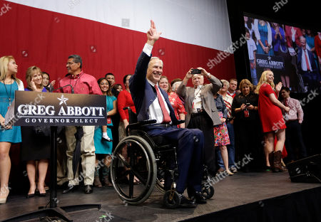Greg Abbott, Election Texas Attorney General and Republican candidate for governor Greg Abbott waves to the crowd after his victory speech, in Austin, Texas. Abbott defeated Democrat Wendy Davis to win the race for Texas governor