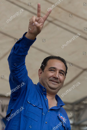 "Samuel Everardo Morales Samuel Everardo Morales, the brother of Guatemala's President Jimmy Morales, flashes a ""vee"" hand symbol at a campaign rally in Chichicastenango, Guatemala. A judge has barred the president's son Jose Manuel Morales Marroquin, and his brother Samuel, from leaving the country. They are under investigation for possible corruption"
