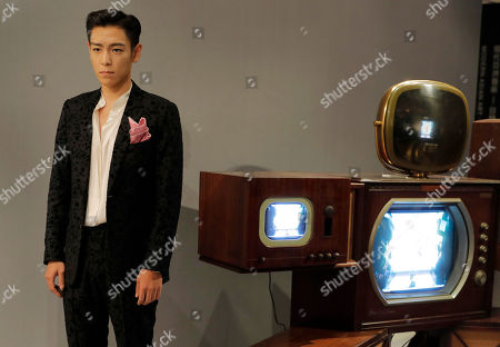 "Choi Seung-hyun, T.O.P Singer and actor Choi Seung-hyun, better known by his stage name T.O.P, of South Korean boy band BIGBANG, poses in front of an art installation titled ""Fat Boy"" by Korean American artist Nam June Paik during a Sotheby's guest-curated contemporary art auction in Hong Kong, China, . The installation which curated by T.O.P. is expected to fetch US$449,000-577,500"