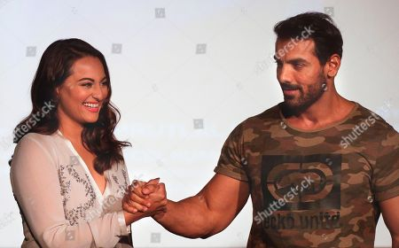 John Abraham, Sonakshi Sinha Bollywood actors John Abraham, right and Sonakshi Sinha pose for a picture during the trailer launch of their upcoming film Force 2 in Mumbai, India, Thursday, Sept. 29, 2016. The film is scheduled for release on