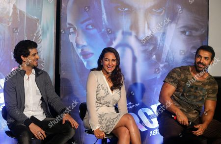 Bollywood actors John Abraham right, along with Sonakshi Sinha, center and Tahir Raj Bhasin left, sit during the trailer launch of their upcoming film Force 2 in Mumbai, India, Thursday, Sept. 29, 2016 . The film is scheduled for release on