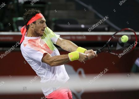 Juan Monaco Juan Monaco, of Argentina returns a shot to James Duckworth, of Australia, during their singles match at the Japan Open men's tennis tournament in Tokyo