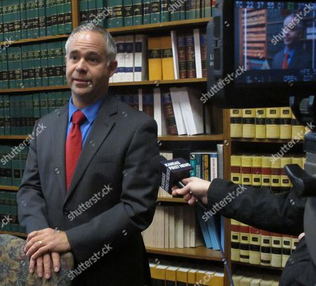 U.S. Rep. Tim Huelskamp, a Kansas Republican, ponders questions from reporters after filing for re-election, at the Kansas secretary of state's office in Topeka, Kan. Huelskamp is seeking his third term in the 1st District of western and central Kansas