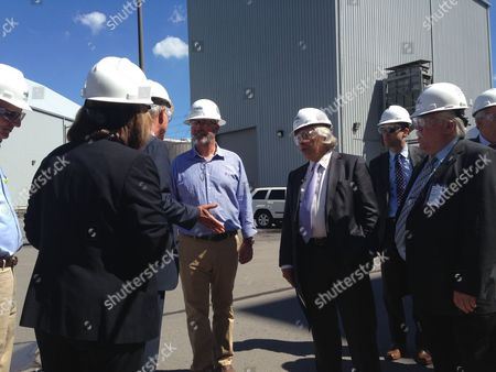 """U.S. Energy Secretary Ernest Moniz, center, tours Longview Power coal fired power plant with energy leaders and political leaders, including Sen. Joe Manchin, on in Maidsville, WV. Moniz says the """"war on coal"""" political messaging is untrue, adding that the Obama administration is working to keep coal an important part of a low-carbon energy future"""