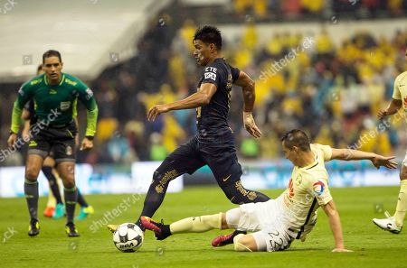 Stock Photo of Jesus Vasconcelos, Paul Aguilar Pumas' Jesus Vasconcelos, left, controls the ball under pressure from America's Paul Aguilar during a Mexican soccer league match in Mexico City