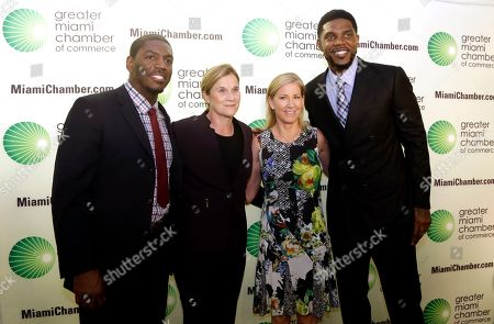 Stock Picture of Jonathan Vilma, Jill Ellis, Chris Evert, Udonis Haslem Greater Miami Chamber of Commerce Sports Hall of Champions inductees, from left, Jonathan Vilma, former NFL football player for the New Orleans Saints; Jill Ellis, coach of the U.S. women's soccer team; former tennis player Chris Evert, and Miami Heat player Udonis Haslem, pose for a photo as they arrive for a ceremony, in Miami. Evert, who was honored in 2015, was accepting the award on behalf of her father and coach Jimmy Evert, who was inducted for a lifetime contribution to sports
