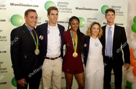 Stock Image of Sam Dorman, Robin Prendes, Brianna Rollins, Angelica Delgado, Dave Hughes U.S. Olympians, from left to right, Sam Dorman, diving silver medalist, Robin Prendes, rowing competitor, Brianna Rollins, track and field gold medalist, Angelica Delgado, judo competitor, and Dave Hughes, sailing competitor, arrive for the Greater Miami Chamber of Commerce Sports Hall of Champions, in Miami. The annual event honors athletes who have brought recognition to South Florida