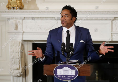 Q-Tip Kennedy Center's Artistic Director for Hip-Hop Culture, Q-Tip, reads a poetry, during the National Student Poets event, in the State Dining Room of the White House in Washington