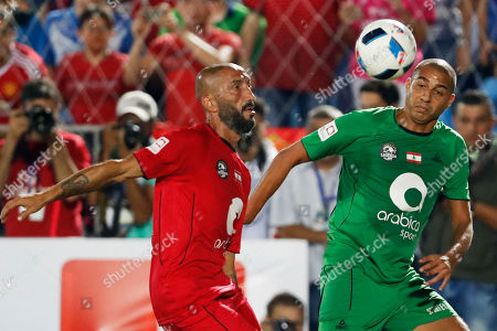 Former star soccer player, David Trezeguet, right, from France fights for the ball with Lebanese former soccer star Mohamad Kasas, left, during a legends soccer match at the Fouad Chehab stadium in the coastal town of Jounieh, Lebanon