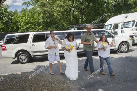 IMAGE DISTRIBUTED FOR MIKE'S HARD LEMONADE - Country music fans and real-life couples Lisa Taylor and Jerry Drozdiel, left, and Nikki and Joseph Walsh, right, arrive at the Lakewood Amphitheatre to tie the knot in an unconventional backyard wedding, hosted by mike's hard lemonade, before the start of the Randy Houser concert, Friday, July 15, 2016, in Atlanta.