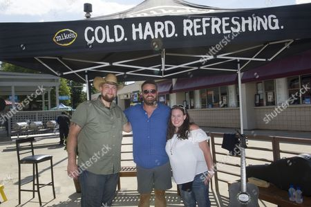 IMAGE DISTRIBUTED FOR MIKE'S HARD LEMONADE - Country music singer and songwriter Randy Houser poses with fans and real-life couple Nikki and Joseph Walsh following a performance for their first dance after tying the knot in a backyard wedding, hosted by mike's hard lemonade, before his concert at the Lakewood Amphitheatre, Friday, July 15, 2016, in Atlanta.