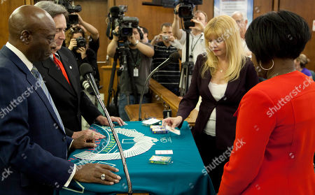 Linda Meisenheimer, Tanya Flanagan Linda Meisenheimer, second from right, puts down a king of diamonds after drawing it from the deck during a draw of cards to determine a tie break for second place with Tanya Flanagan, right, in the city's April 5, Ward 2 primary election, in North Las Vegas, Nev. Meisenheimer's king bested Flanagan's five of diamonds to win the draw and advance to the June 7 general election against Pamela Goynes-Brown. Presiding over the draw of cards was David Hernandez, second from left, head of the College of Southern Nevada casino management program, and North Las Vegas Mayor Pro Tem William Robinson. Nevada is the only state that uses a draw of the cards to break an election tie
