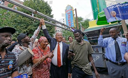 Bill Thompson West-African Malian talking drum master Baye Kouyate, second from left, raises the hand of New York City Democratic Mayoral hopeful Bill Thompson, center, as Thompson campaigned with members of the West African community at the Malcolm Shabazz Harlem Market, in New York. The Democratic primary election is Tuesday, Sept. 10