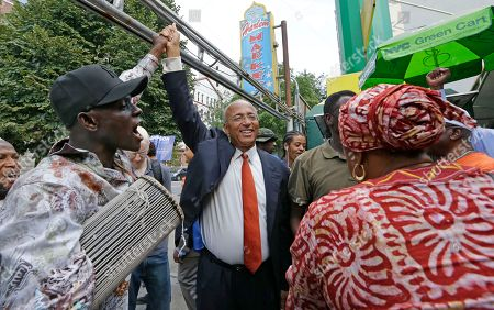 Bill Thompson West-African Malian talking drum master Baye Kouyate, left, celebrates with New York City Democratic Mayoral hopeful Bill Thompson, center, as Thompson campaigned with members of the West African community at the Malcolm Shabazz Harlem Market, in New York. The Democratic primary election is Tuesday, Sept. 10