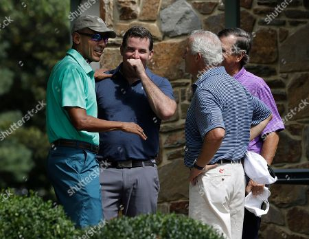 Barack Obama, Kevin Plank President Barack Obama speaks to Under Armour CEO and Chairman Kevin Plank, second from left, and two others before playing a round of golf at Caves Valley Golf Club in Owings Mills, Md