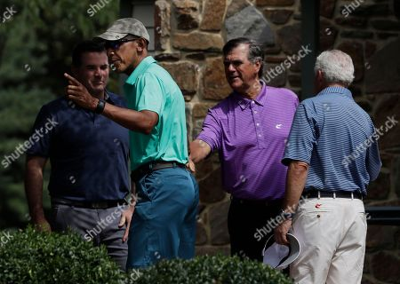Barack Obama, Kevin Plank President Barack Obama speaks to Under Armour CEO and Chairman Kevin Plank, left, and with two others before playing a round of golf at Caves Valley Golf Club in Owings Mills, Md