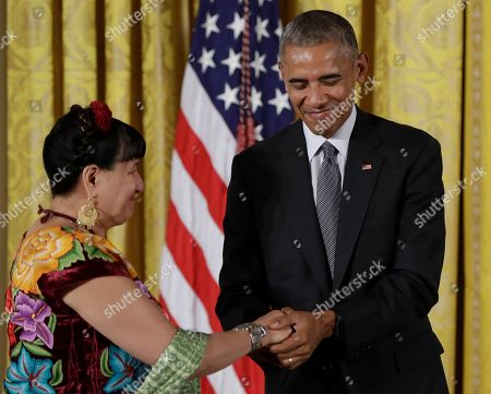 Stock Picture of Barack Obama, Sandra Cisneros President Barack Obama awards the 2015 National Medal of Arts to author Sandra Cisneros in the East Room of the White House, in Washington