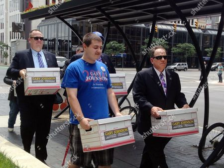 Libertarian Party activists in Ohio carry boxes of signature petitions to the Secretary of State's Office, in Columbus, Ohio, in hopes of placing presidential candidate Gary Johnson on the November ballot. The party surprised state election officials by submitting signatures for a different candidate, Charlie Earl, who ran unsuccessfully for governor in 2014,  in a move Libertarians defended as a placeholder effort because they began collecting signatures before Johnson was nominated. Once certified by the state's elections chief, Libertarians will swap in Johnson and his running mate