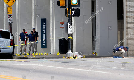 An FBI evidence response team works the scene where one or more gunmen opened fire on Dallas police officers last night in Dallas, Friday, July 8, 2016. A peaceful protest in Dallas over the recent videotaped shootings of black men by police turned violent Thursday night as an unknown number of people shot at officers, killing five and injuring seven, as well as two civilians.