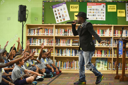 Stock Picture of Tray Chaney Actor and musician Tray Chaney performs for students of Amidon-Bowen Elementary School for Reading Is Fundamental's 50th Anniversary, in Washington, D.C