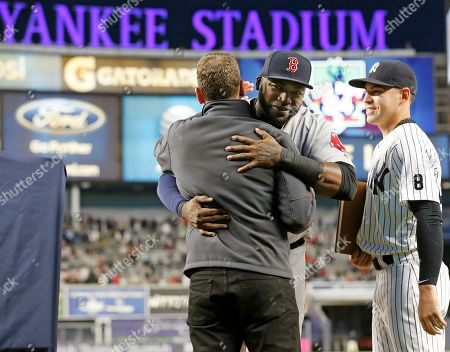 David Ortiz, David Cone, Jacoby Ellsbury Boston Red Sox designagted hitter David Ortiz embraces YES network broadcaster New York Yankees and former New York Yankees' pitcher David Cone as the Yankees' Jacoby Ellsbury, right, looks on in a pregame ceremony before baseball game between the Yankees and the Red Sox in New York, . Ortiz was honored for his last game at Yankee Stadium. He plans to retire at the end of the 2016 season