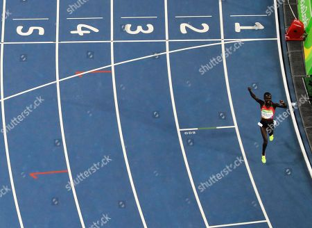 Kenya's Vivian Jepkemoi Cheruiyot reacts after winning the gold medal in the 5000 meter finals during the athletics competitions of the 2016 Summer Olympics at the Olympic stadium in Rio de Janeiro, Brazil