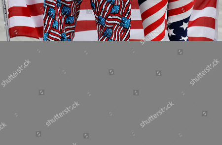 Mary and George Kay of the United States wear national colors as they stand in Olympic Park during the 2016 Summer Olympics in Rio de Janeiro, Brazil
