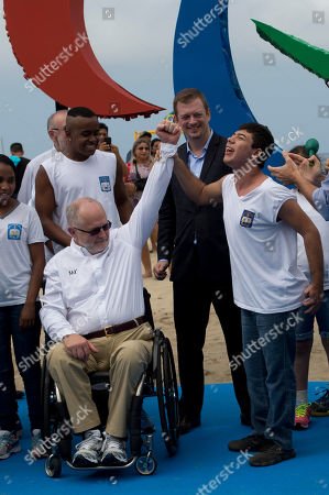 Philip Craven A visually impaired student raises the arm of International Paralympic Committee President Sir Philip Craven, during the unveiling of the Agitos statue, symbol of the Paralympic Games, in Rio de Janeiro, Brazil, . The International Paralympic Committee unveiled the sculpture made ??of recycled plastic, full of different textures and smells, ahead of the Games that start on Sept. 7