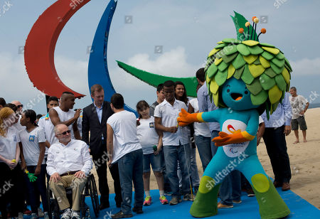 Philip Craven International Paralympic Committee President Sir Philip Craven, left, poses for photos with Tom, the mascot of the Rio Paralympics Games, on Copacabana beach in Rio de Janeiro, Brazil, . The International Paralympic Committee unveiled the sculpture of the Agitos, behind, symbol of the Paralympic Games, which is made ??of recycled plastic, full of different textures and smells. The Rio Paralympics Games are scheduled to start on Sept. 7