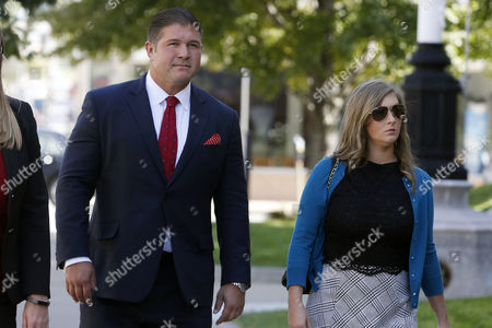 Jesse Benton, left, arrives for his sentencing hearing with wife Valori Pyeatt, at the federal courthouse in Des Moines, Iowa. Jesse Benton and John Tate, two top aides to Ron Paul's 2012 presidential bid were sentenced Tuesday to probation and home confinement rather than prison for their roles in a scheme to cover up campaign payments to a former Iowa state senator who agreed to endorse their boss