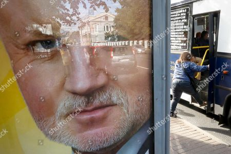 An election poster with a portrait of Just Russia party leader Sergei Mironov is placed in St. Petersburg, Russia, . Russia's parliamentary election will be held on Sunday