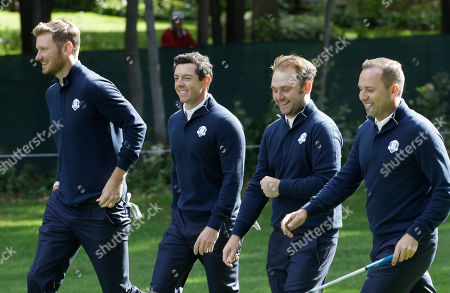 Europe's Chris Woods, left to right, Europe's Rory McIlroy, Europe's Andy Sullivan and Europe's Sergio Garcia walk down the fifth fairway during a practice round for the Ryder Cup golf tournament, at Hazeltine National Golf Club in Chaska, Minn