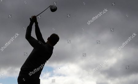 Europe's Chris Woods hits a drive on the 11th hole during a practice round for the Ryder Cup golf tournament, at Hazeltine National Golf Club in Chaska, Minn