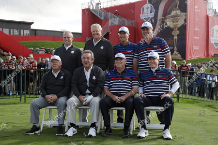 Former Ryder Cup captains pose for a picture before the Ryder Cup Captains Match, at Hazeltine National Golf Club in Chaska, Minn. Standing, left to right, Paul McGinley, Colin Montgomerie, Ben Crenshaw, Hal Sutton. Seated left to right, Ian Woosnam, Tony Jacklin, Lanny Wadkins and Dave Stockton