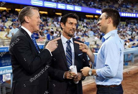 Joe Davis, Orel Hershiser, Nomar Garciaparra Dodgers broadcasters, from left, Orel Hershiser, Nomar Garciaparra and Joe Davis chat prior to a baseball game between the Los Angeles Dodgers and the San Francisco Giants, in Los Angeles. As Vin Scully closes out his Hall of Fame career calling Los Angeles Dodgers games, his successor is waiting in the wings. Joe Davis has been working road games for the team this season, warming up for next year when the 28-year-old will move into Scully's old booth full-time