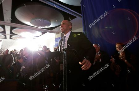 Stock Photo of Cory Booker Sen. Cory Booker, D-N.J., arrives to an election night victory gathering, in Newark, N.J. Booker, who won a special election last year for the seat that was vacated by the death of Democratic U.S. Sen. Frank Lautenberg, went up against Republican challenger Jeff Bell