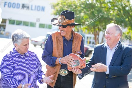 From left: Kay Carter, CEO of Second Harvest Food Bank of Metrolina, racing legend Richard Petty and Dennis Pittman, senior director of hunger relief for Smithfield Foods, unload a portion of Smithfield's 70,000 pound protein donation to the food bank, in Concord, N.C