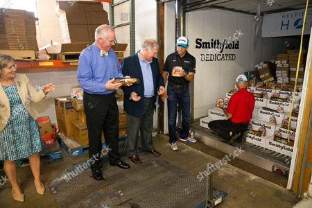 IMAGE DISTRIBUTED FOR SMITHFIELD - Representatives from Kroger, the Freestore Foodbank and Smithfield join Richard Petty Motorsports No.43 driver Aric Almirola to unload a portion of Smithfield's 25,000-pound protein donation to the food bank, at the Freestore Foodbank on Thursday, July 7, 2016 in Cincinnati.