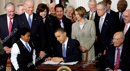 Barack Obama President Barack Obama signs the health care bill in the East Room of the White House in Washington. He is flanked by Marcelas Owens of Seattle, left, and Rep. John Dingell, D-Mich. Behind, from left are, Sen. Tom Harkin, D-Iowa., Senate Majority Whip Richard Durbin of Ill., Vice President Joe Biden, Vicki Kennedy, widow of Sen. Ted Kennedy, Sen. Christopher Dodd, D-Conn., Rep. Sander Levin, D-Mich., Ryan Smith of Turlock, Calif., Health and Human Services Secretary Kathleen Sebelius, House Speaker Nancy Pelosi of Calif., House Majority Leader Steny Hoyer of Md., Senate Majority Leader Harry Reid of Nev., Rep. Patrick Kennedy, D-R.I., House Majority Whip James Clyburn of S.C., and Rep. Henry Waxman, D-Calif. The Supreme Court said Monday it will hear arguments in March over President Barack Obama's health care overhaul, setting up an election-year showdown over the White House's main domestic policy achievement