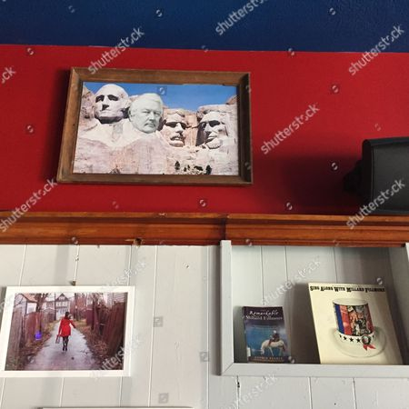 Stock Photo of This April 23, 2016 photo shows a picture of Mount Rushmore altered to include Millard Fillmore's face, hanging on the wall at the Millard Fillmore Presidential Library, a dive bar in Cleveland, Ohio. Ohio is the birthplace of seven presidents but Fillmore is from New York. The bar's owner, Tom Bell, themed the bar on Fillmore as a joke.