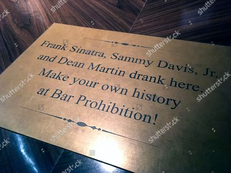 A plaque is shown at the historic Golden Gate Hotel and Casino's Bar Prohibition in Las Vegas announcing where Frank Sinatra, Sammy Davis, Jr. and Dean Martin regularly visited during their popular days as Las Vegas performers. Although Sinatra's presence in Sin City has faded, fans can still locate pieces of his Las Vegas legacy with a little homework and a desire to look beyond popular, contemporary tourist attractions